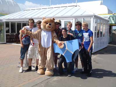 Bear poses with lads